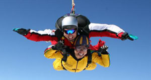 Two people skydiving in Seville